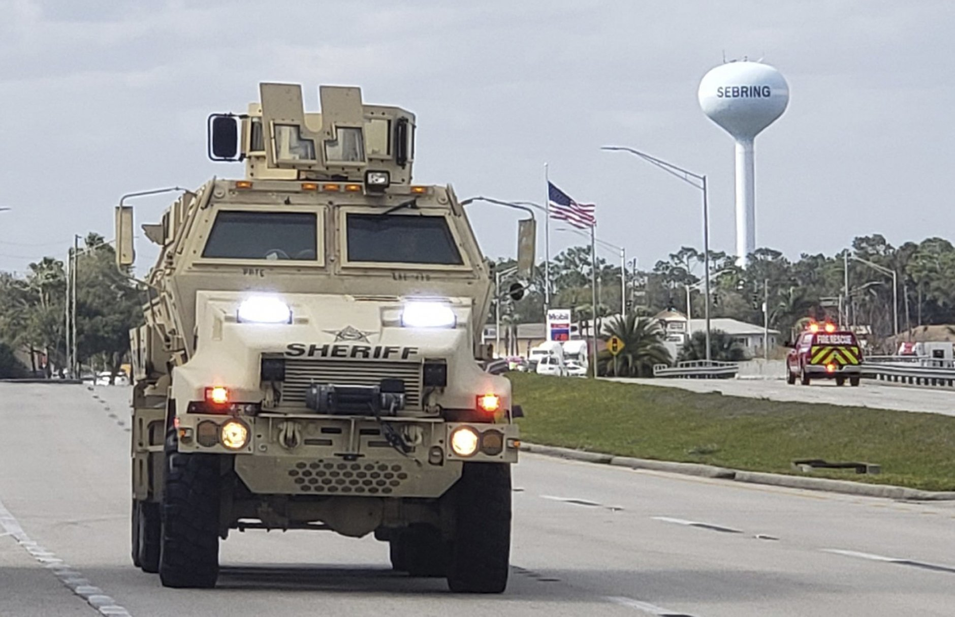 A sheriff's department armored vehicle arrives at a SunTrust Bank branch, Wednesday, Jan. 23, 2019, in Sebring, Fla. Authorities say they've arrested a man who fired shots inside the Florida bank. (The News Sun via AP)