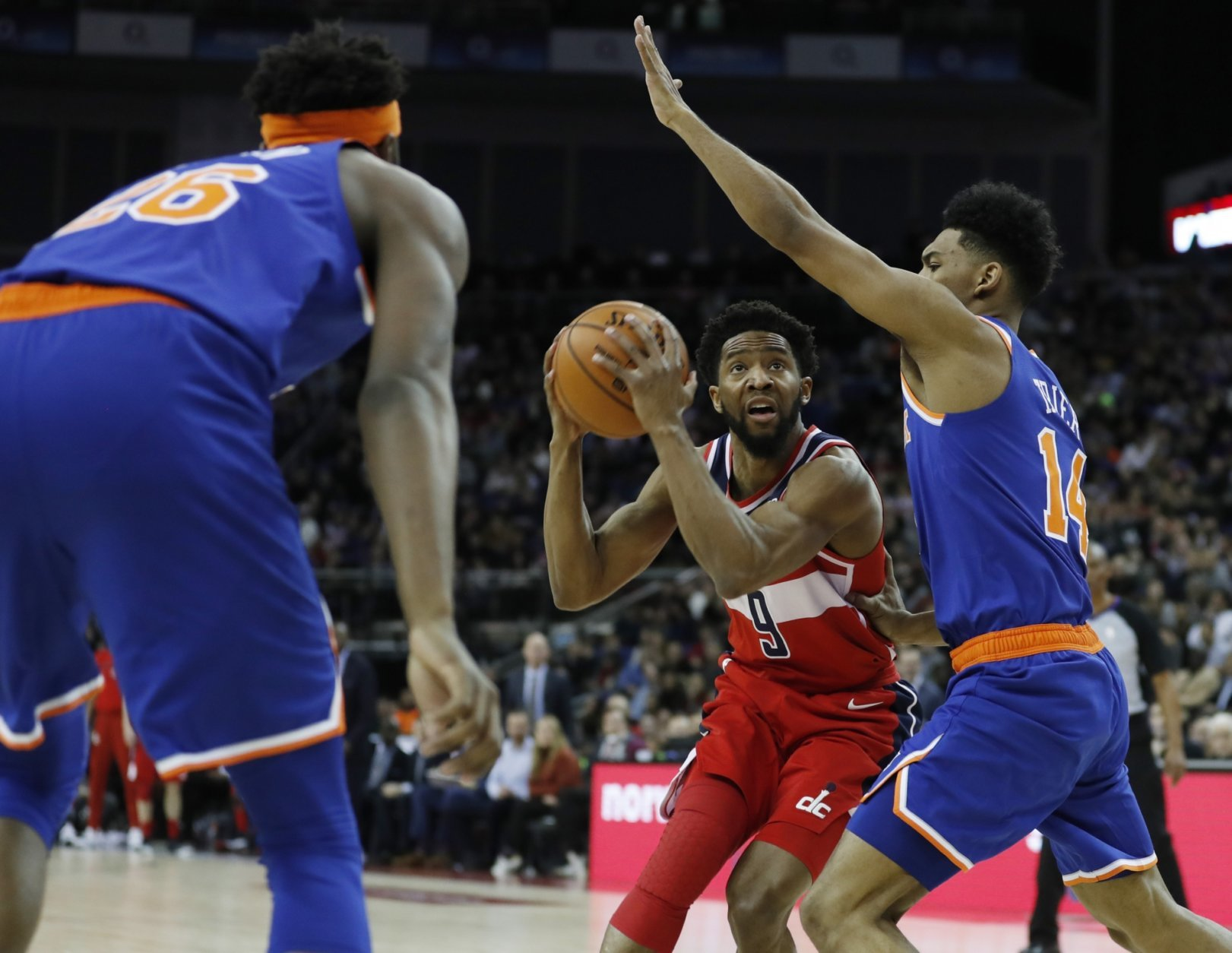 Washington Wizards guard Chasson Randle (9) drives to the basket as New York Knicks guard Allonzo Trier (14) defends, during an NBA basketball game between New York Knicks and Washington Wizards at the O2 Arena, in London, Thursday, Jan.17, 2019. (AP Photo/Alastair Grant)