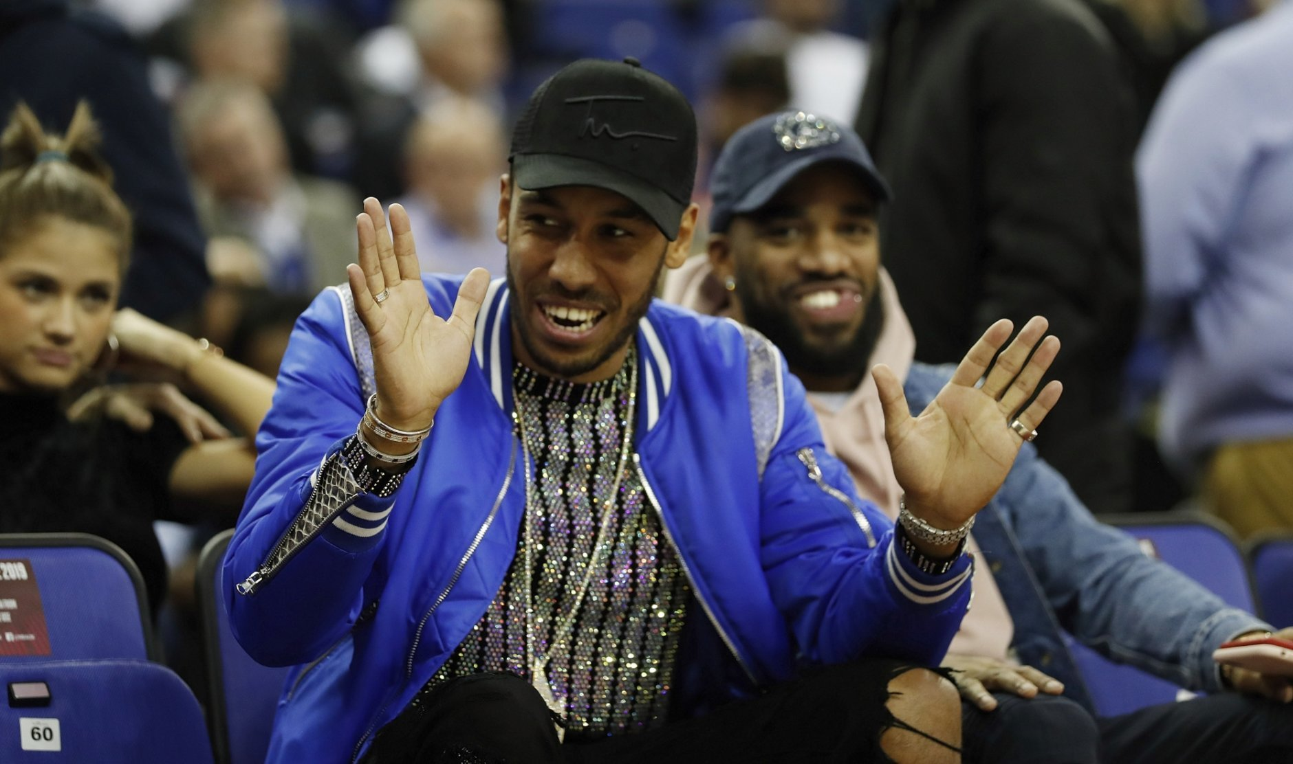 Arsenal player Pierre-Emerick Aubameyang gestures as he attends a NBA basketball game between New York Knicks and Washington Wizards at the O2 Arena, in London, Thursday, Jan.17, 2019. (AP Photo/Alastair Grant)