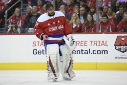Washington Capitals goaltender Braden Holtby (70) stands on the ice after he was injured during the second period of an NHL hockey game against the Columbus Blue Jackets, Saturday, Jan. 12, 2019, in Washington. (AP Photo/Nick Wass)