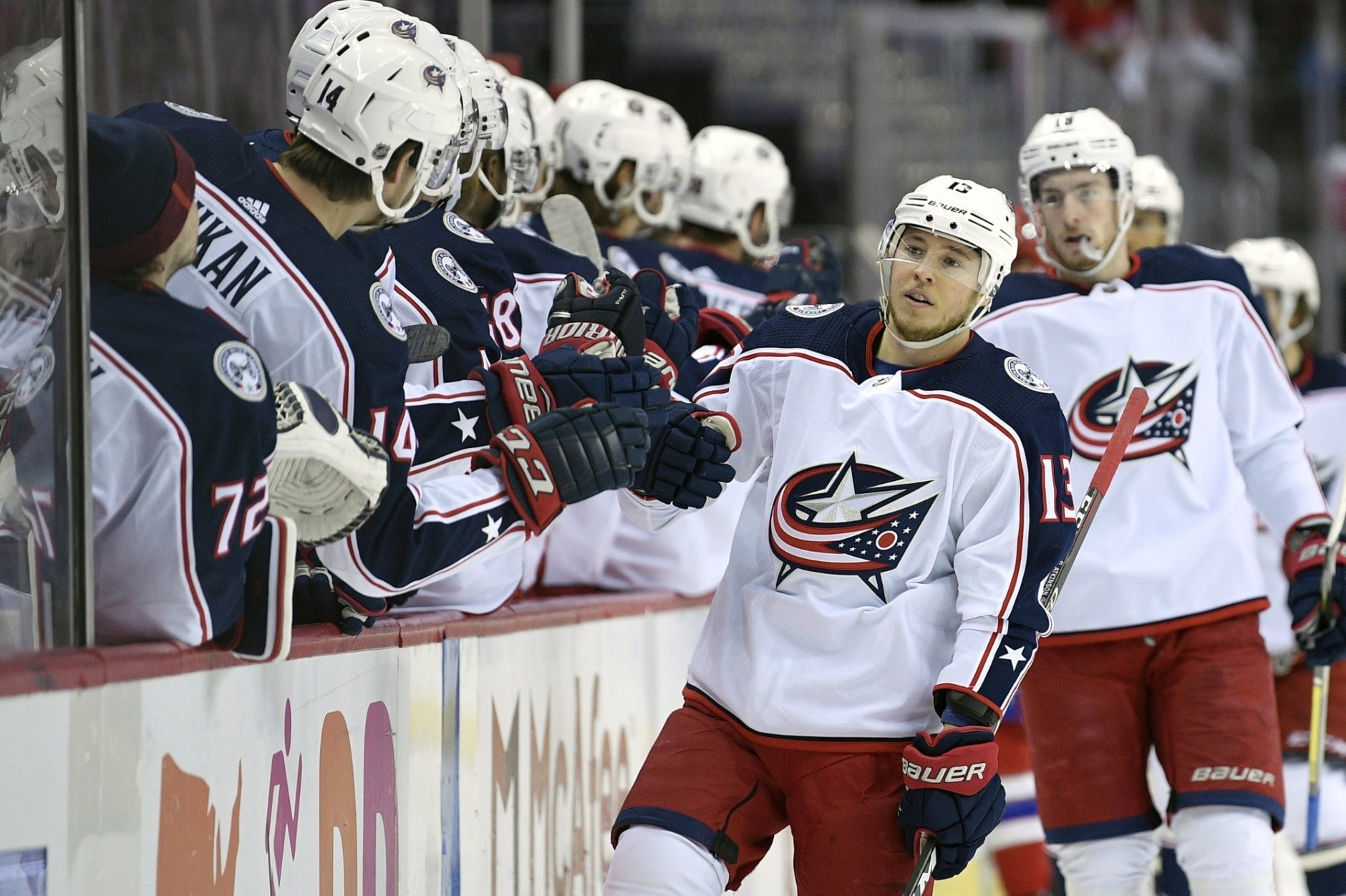 Columbus Blue Jackets right wing Cam Atkinson (13) celebrates his goal during the first period of an NHL hockey game against the Washington Capitals, Saturday, Jan. 12, 2019, in Washington. (AP Photo/Nick Wass)