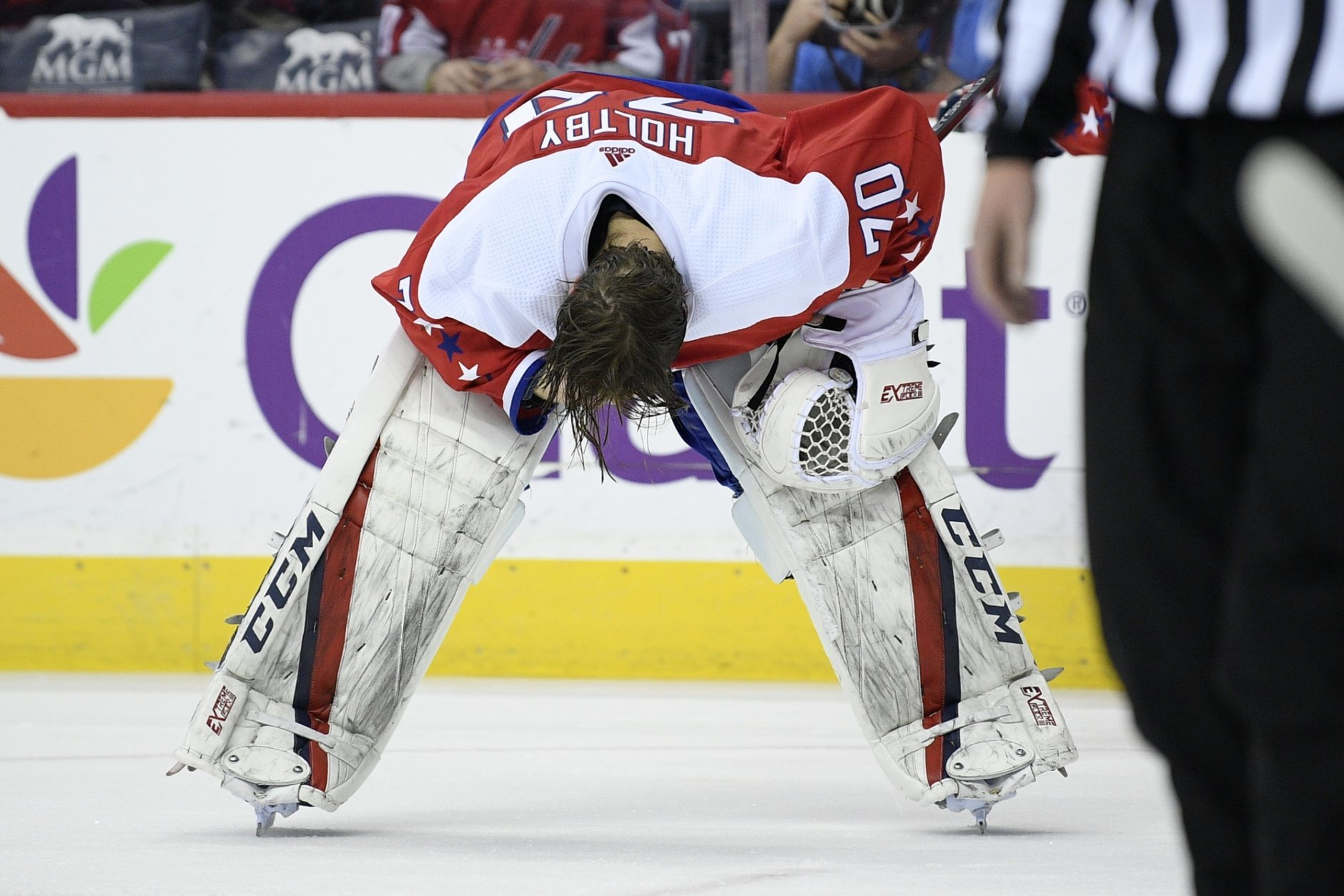 Washington Capitals goaltender Braden Holtby (70) pauses on the ice after he was injured during the second period of an NHL hockey game against the Columbus Blue Jackets, Saturday, Jan. 12, 2019, in Washington. (AP Photo/Nick Wass)