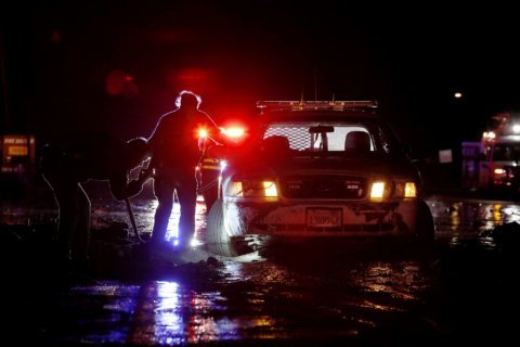 California storm brings power outages, shuts down highway