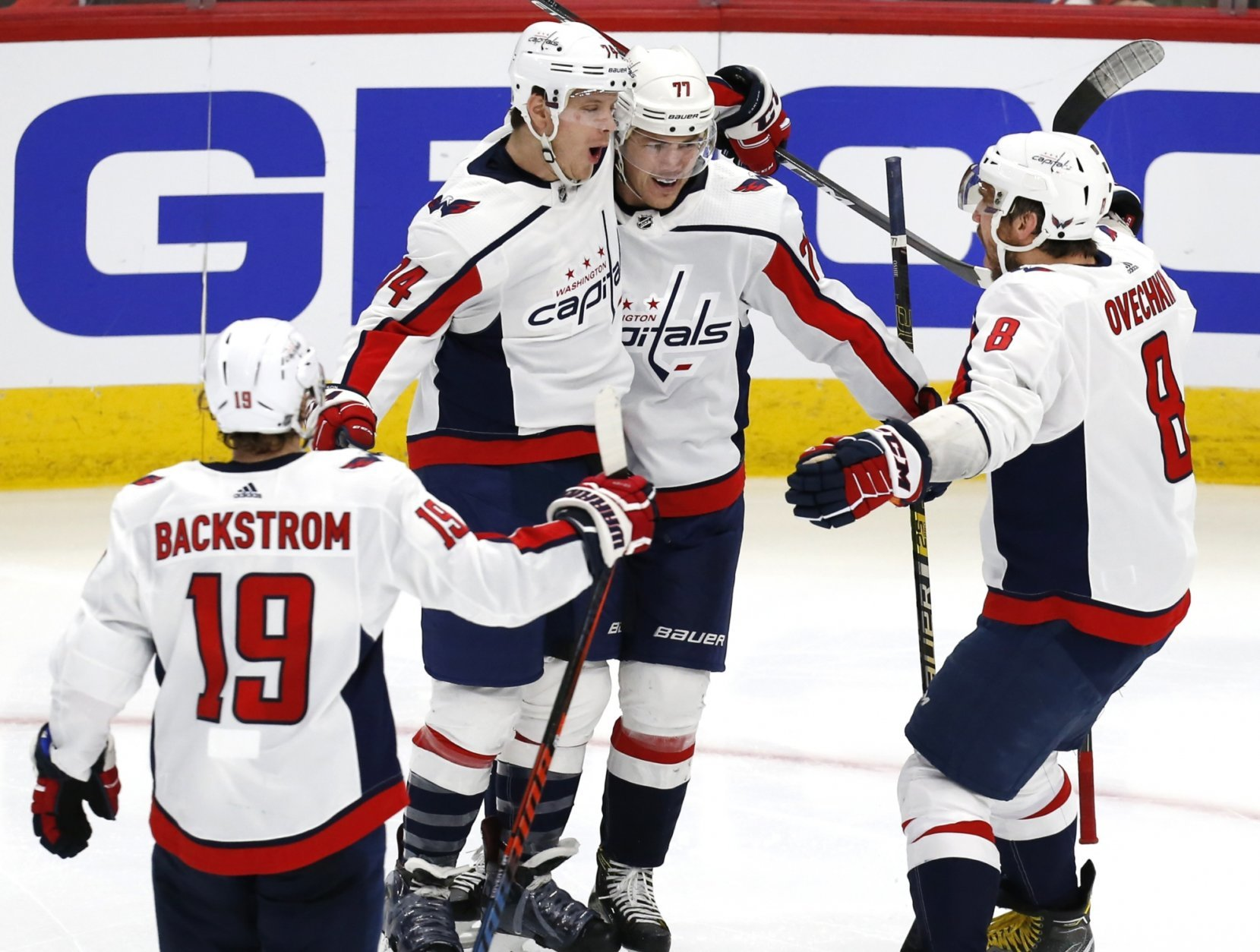 Second from left Washington Capitals defenseman John Carlson (74) celebrates with teammates after his goal against the Chicago Blackhawks, during the third period of an NHL hockey game Sunday, Jan. 20, 2019, in Chicago. (AP Photo Nuccio DiNuzzo)