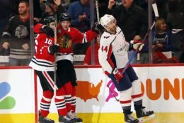 Washington Capitals defenseman Brooks Orpik (44) skates away as center Chicago Blackhawks left wing Brandon Saad, center, celebrates with center Marcus Kruger (16) after his goal during the first period of an NHL hockey game Sunday, Jan. 20, 2019, in Chicago. (AP Photo Nuccio DiNuzzo)