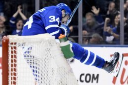 Toronto Maple Leafs center Auston Matthews (34) celebrates after scoring a goal during a power play against the Washington Capitals in second period of an NHL hockey game, Wednesday, Jan. 23, 2019, in Toronto. (Nathan Denette/The Canadian Press via AP)