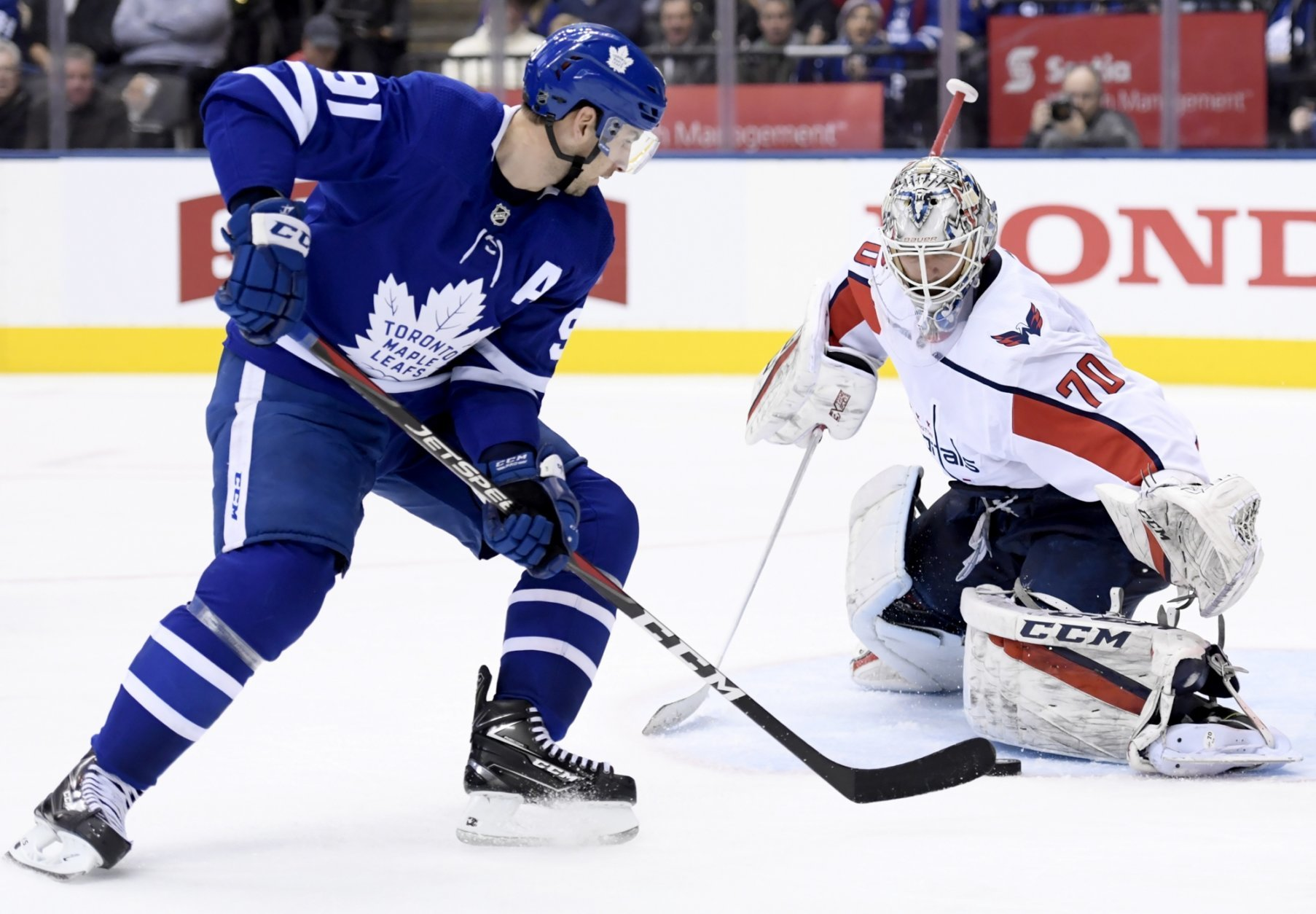 Washington Capitals goaltender Braden Holtby (70) stops Toronto Maple Leafs center John Tavares (91) during the second period of an NHL hockey game, Wednesday, Jan. 23, 2019, in Toronto. (Nathan Denette/The Canadian Press via AP)