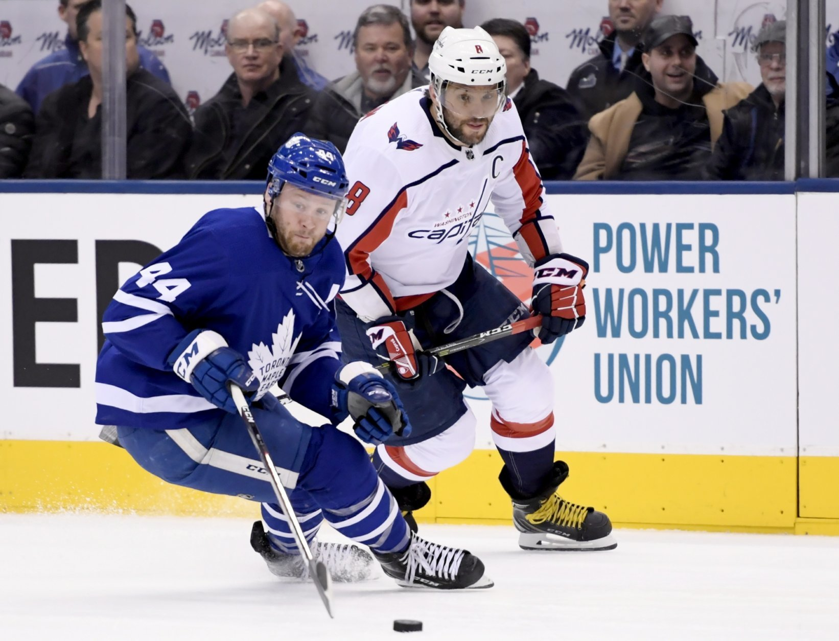 Washington Capitals left wing Alex Ovechkin (8) chases down Toronto Maple Leafs defenseman Morgan Rielly (44) during the first period of an NHL hockey game, Wednesday, Jan. 23, 2019, in Toronto. (Nathan Denette/The Canadian Press via AP)
