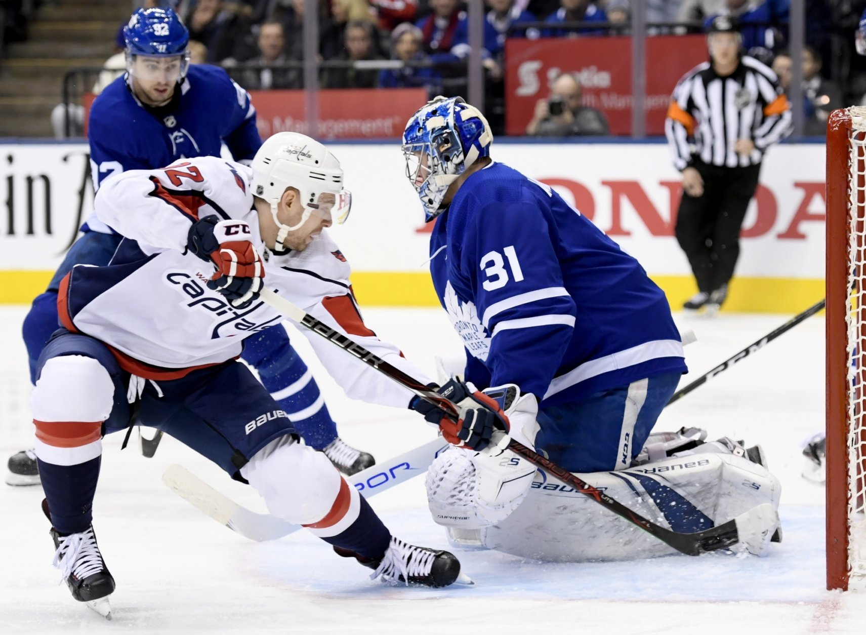 Washington Capitals center Evgeny Kuznetsov (92) gets stopped by Toronto Maple Leafs goaltender Frederik Andersen (31) during the first period of an NHL hockey game, Wednesday, Jan. 23, 2019, in Toronto. (Nathan Denette/The Canadian Press via AP)