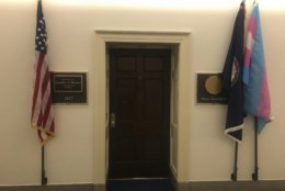 In this photo provided by the Office of Congresswoman Jennifer Wexton, a transgender pride flag, right, is displayed along with U.S. left, and Virginia, second from right, flags, outside newly elected Virginia congresswoman Rep. Jennifer Wexton's office in Washington on Friday, Jan. 4, 2019. Wexton is a Democrat from 10th District in northern Virginia who was sworn in Thursday, Jan. 3. (Office of Congresswoman Jennifer Wexton via AP)
