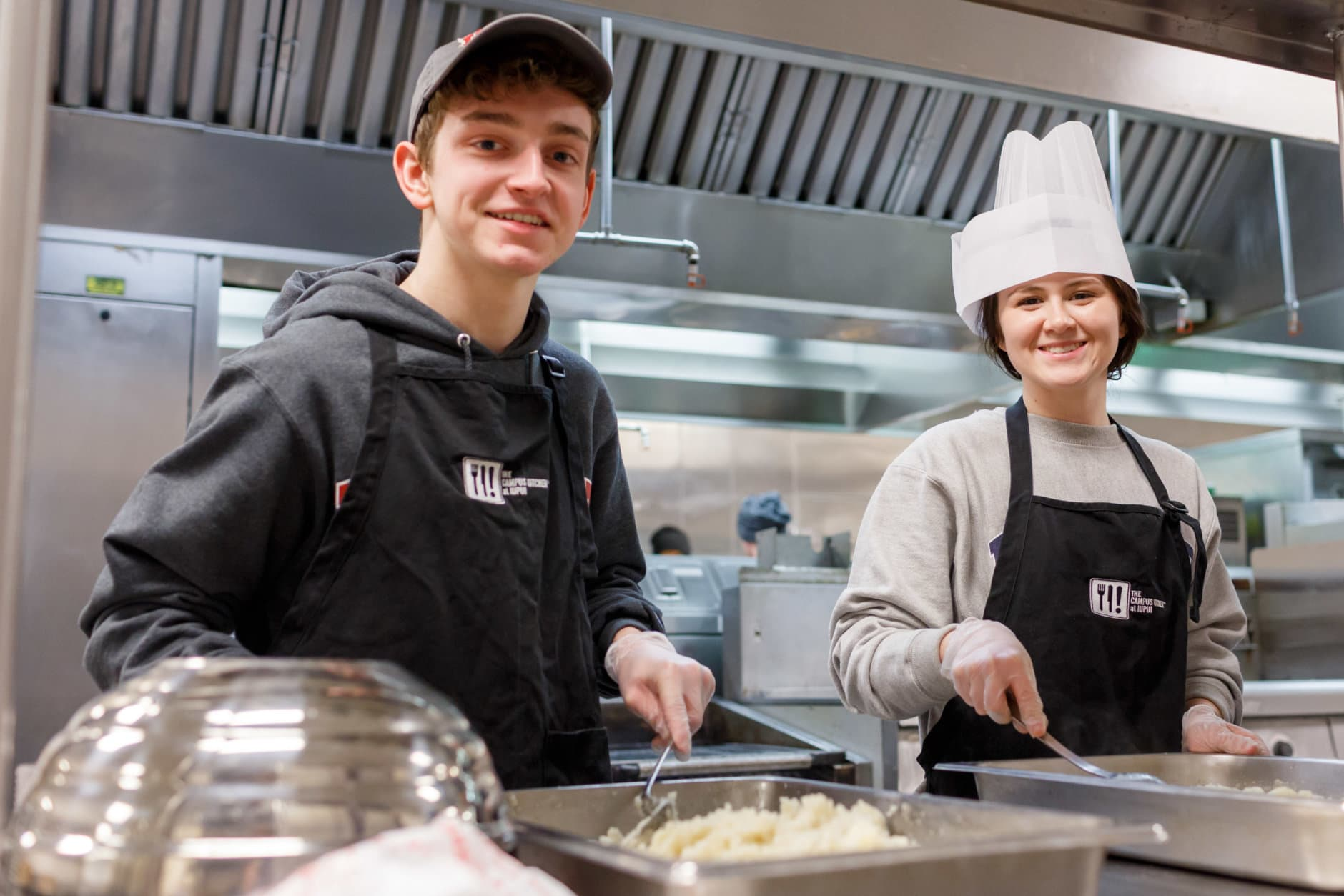 IUPUI students along with staff from Chartwells prepare food for community members on Wednesday February 7, 2018.