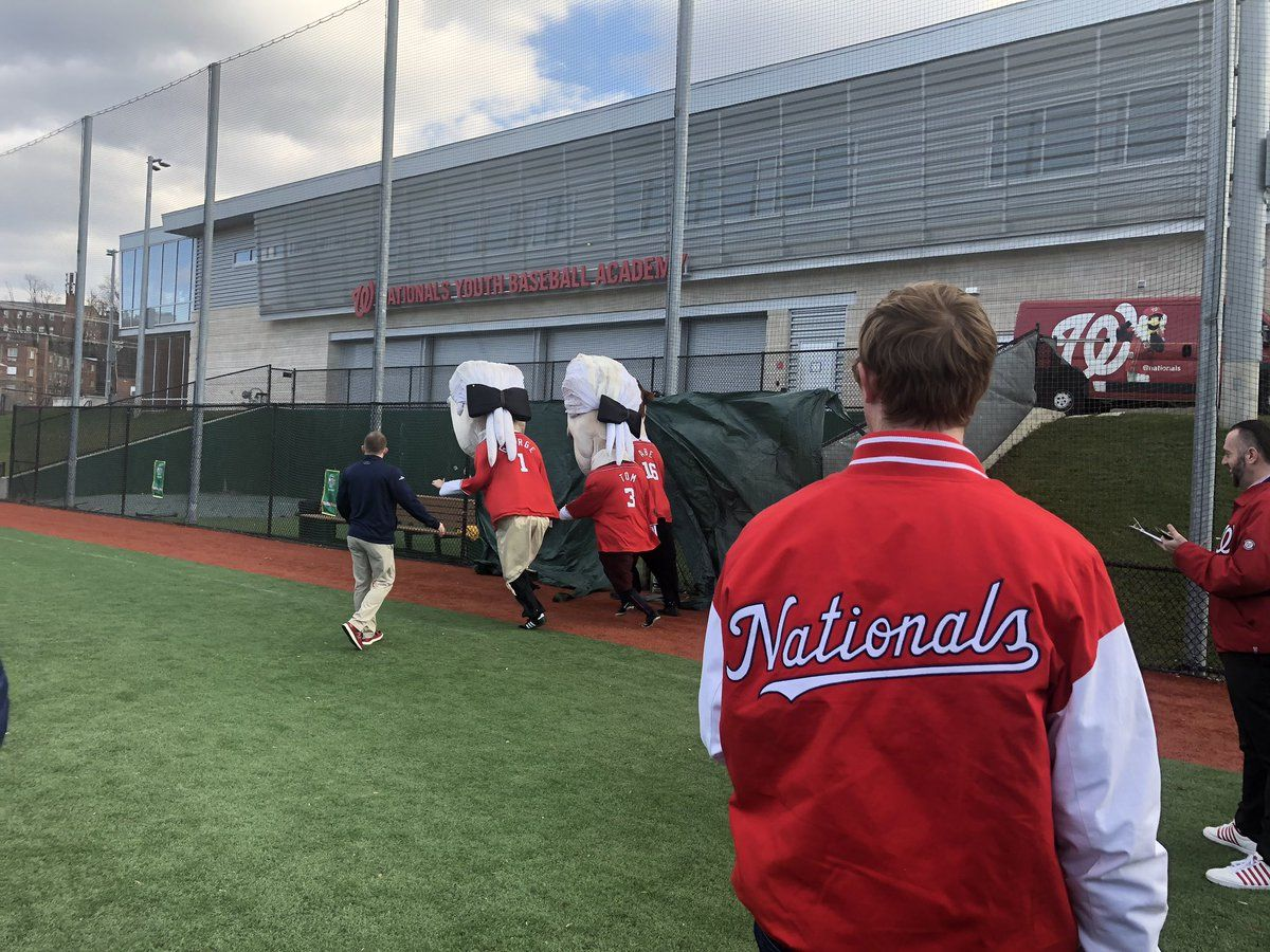In order to make the cut, people auditioning have to run a 40-yard dash and hold their own in two races from center field to first base. (WTOP/Melissa Howell)