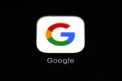 The Latest: Apple axes Google access to key developer tool