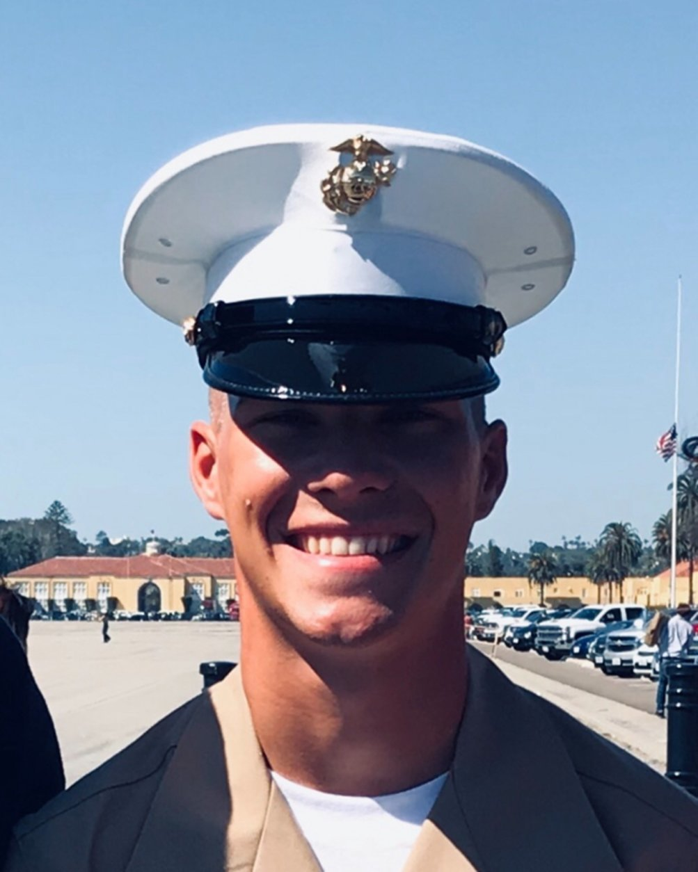 """This 2017 photo provided by Morgan Kuznia shows her brother Riley Kuznia at his Marine graduation ceremony in San Diego. The 20-year-old U.S. Marine from Minnesota was killed in a shooting at the Marine Barracks in Washington, D.C., his mother said Wednesday, Jan. 2, 2019. The U.S. Marine Corps said in a statement that the shooting was under investigation and that there was no danger to local residents """"as the event transpired within the grounds of Marine Barracks 8th and I."""" Marine Corps spokesman Chief Gunnery Sgt. John Jackson said the wound """"was not self-inflicted."""" (Morgan Kuznia via AP)"""