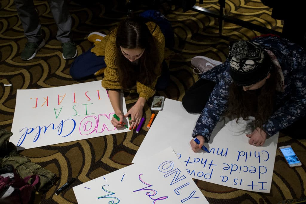 WASHINGTON, DC - JANUARY 17: Pro-Life supporters prepare signs following youth rally during the 2019 March for Life Conference and Expo on January 17, 2019 in Washington, DC. (Photo by Zach Gibson/Getty Images)
