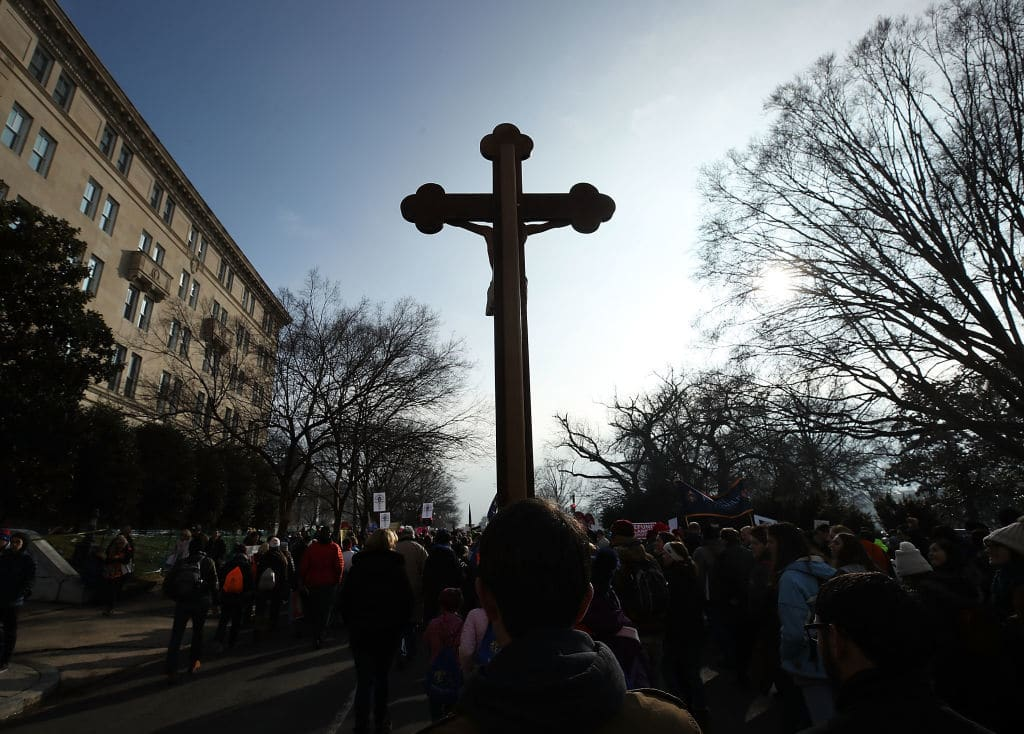 WASHINGTON, DC - JANUARY 18:  A protester carries a Crucifix during the Right To Life March on January 18, 2019 in Washington, DC. The Right to Life Campaign held its annual March For Life rally and march to the U.S. Supreme Court protesting the high court's 1973 Roe V. Wade decision making abortion legal.  (Photo by Mark Wilson/Getty Images)