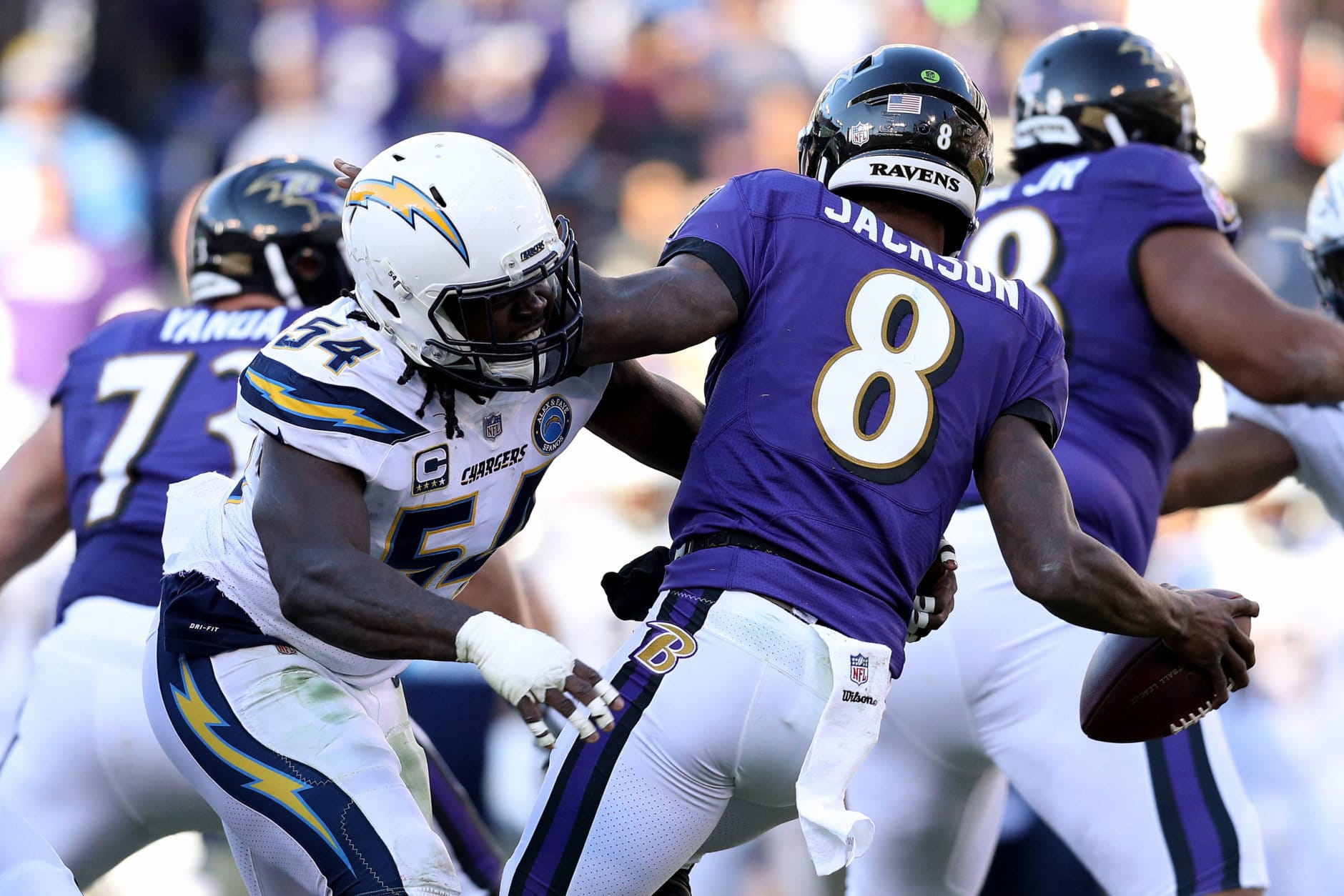 BALTIMORE, MARYLAND - JANUARY 06: Lamar Jackson #8 of the Baltimore Ravens gets sacked by Melvin Ingram #54 of the Los Angeles Chargers during the third quarter in the AFC Wild Card Playoff game at M&T Bank Stadium on January 06, 2019 in Baltimore, Maryland. (Photo by Patrick Smith/Getty Images)