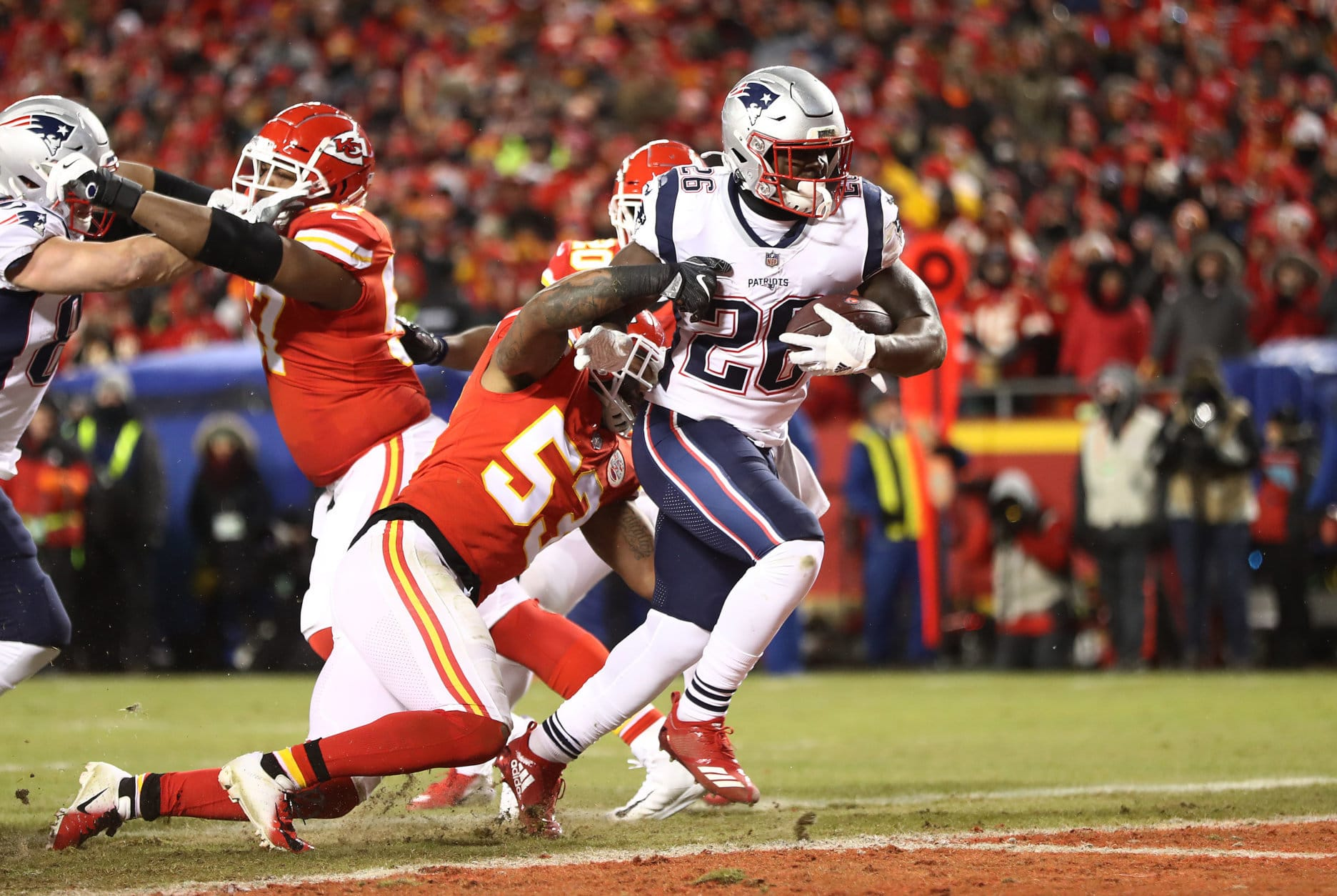 KANSAS CITY, MISSOURI - JANUARY 20:  Sony Michel #26 of the New England Patriots rushes for a 1-yard touchdown in the first quarter as Anthony Hitchens #53 of the Kansas City Chiefs attempts to tackle him during the AFC Championship Game at Arrowhead Stadium on January 20, 2019 in Kansas City, Missouri. (Photo by Jamie Squire/Getty Images)