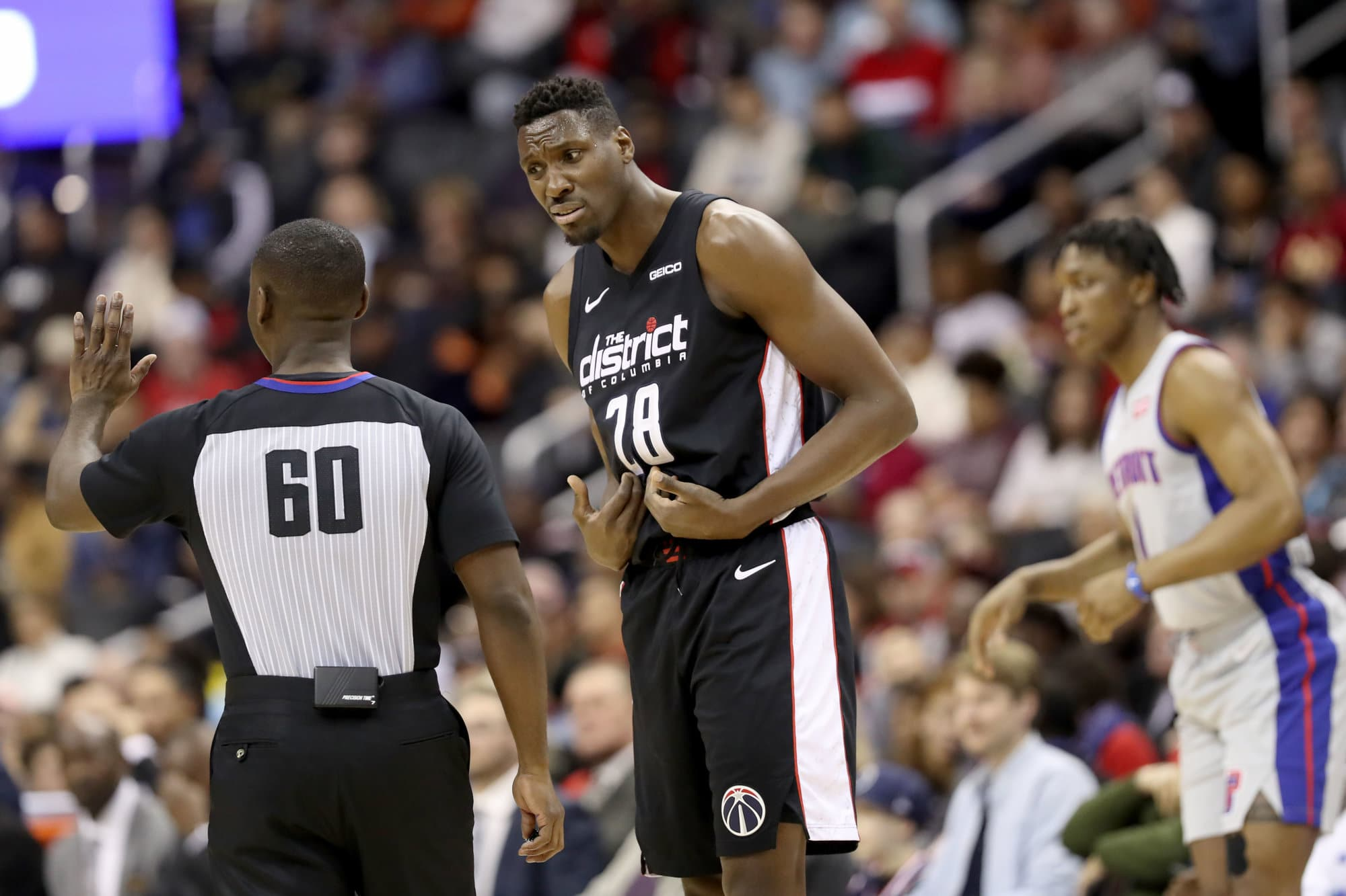 WASHINGTON, DC - JANUARY 21: Ian Mahinmi #28 of the Washington Wizards argues a foul call with referee James Williams #60 during the second half against the Detroit Pistons at Capital One Arena on January 21, 2019 in Washington, DC. NOTE TO USER: User expressly acknowledges and agrees that, by downloading and or using this photograph, User is consenting to the terms and conditions of the Getty Images License Agreement. (Photo by Rob Carr/Getty Images)