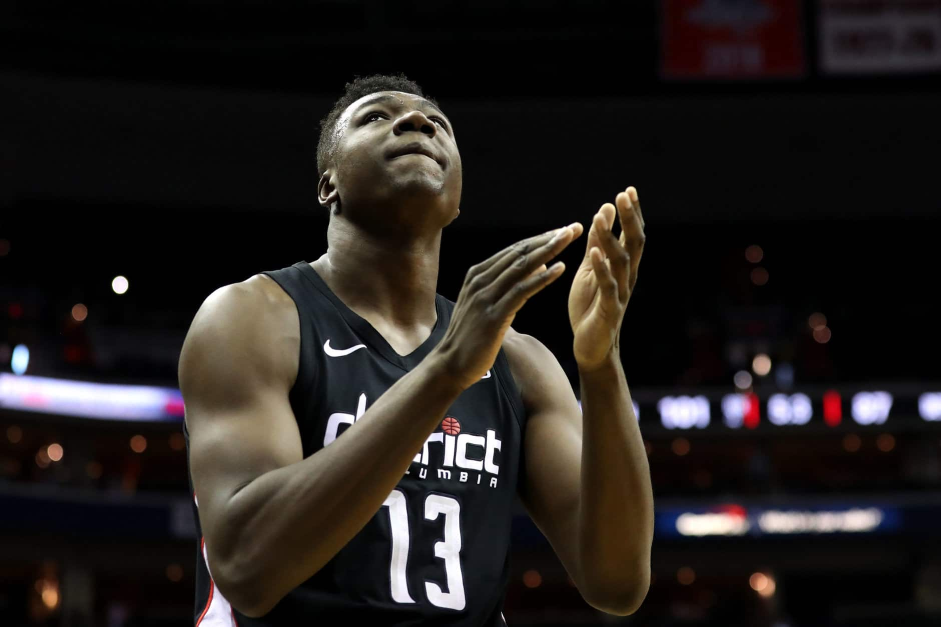 WASHINGTON, DC - JANUARY 21: Thomas Bryant #13 of the Washington Wizards claps during the closing seconds of the Wizards 101-87 win over the Detroit Pistons at Capital One Arena on January 21, 2019 in Washington, DC. NOTE TO USER: User expressly acknowledges and agrees that, by downloading and or using this photograph, User is consenting to the terms and conditions of the Getty Images License Agreement. (Photo by Rob Carr/Getty Images)