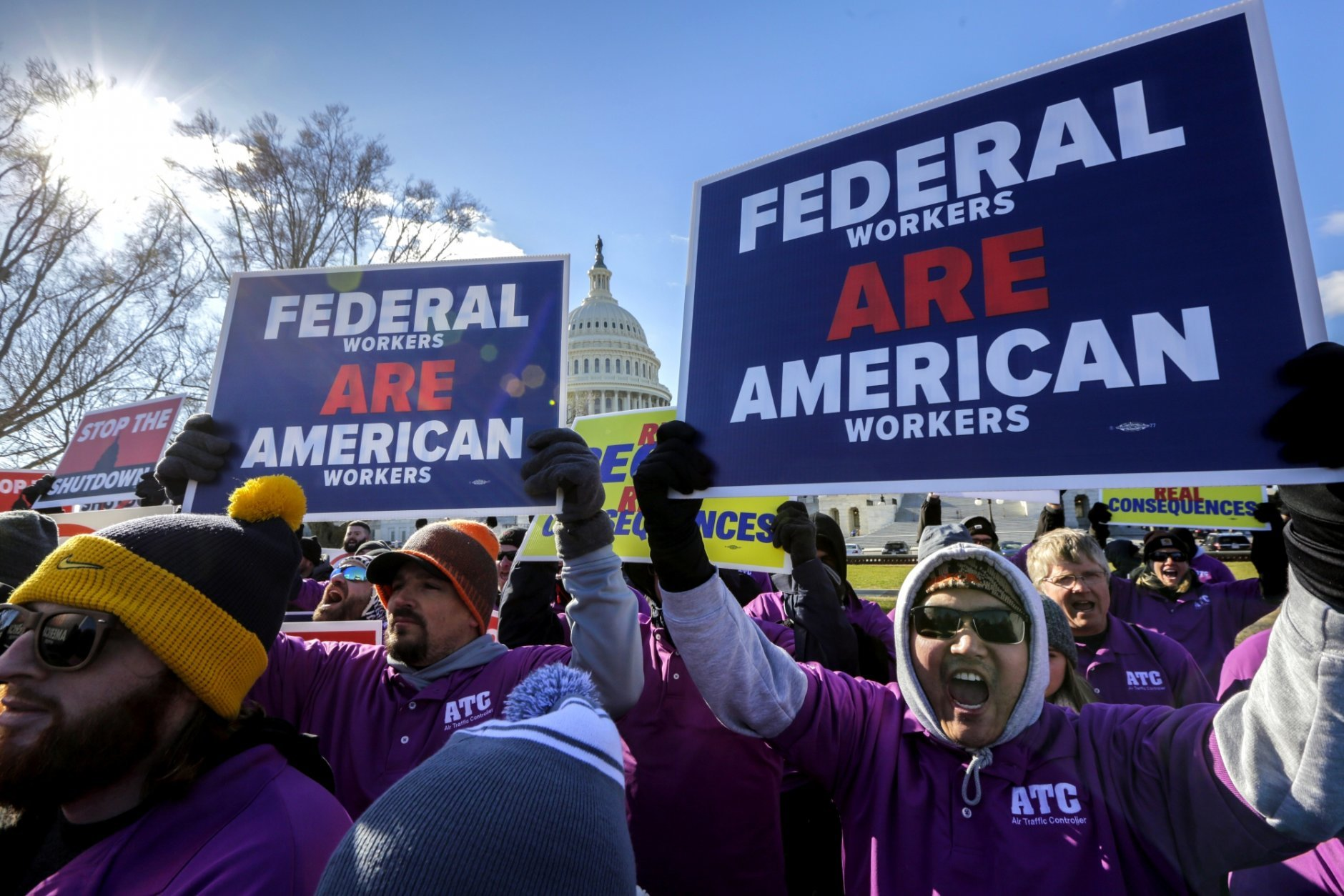 On the 20th day of a partial government shutdown, federal employees rally at the Capitol to protest the impasse between Congress and President Donald Trump over his demand to fund a U.S.-Mexico border wall, in Washington, Thursday, Jan. 10, 2019. (AP Photo/J. Scott Applewhite)
