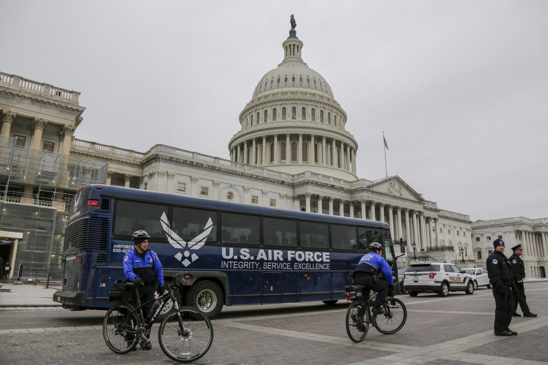 An Air Force bus waits on the plaza of the Capitol after President Donald Trump used his executive power to deny military aircraft to House Speaker Nancy Pelosi just before she was depart to visit troops abroad, on Capitol Hill in Washington, Thursday, Jan. 17, 2019.(AP Photo/J. Scott Applewhite)