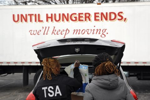 At area food banks, feds lend a hand — even though they themselves need help
