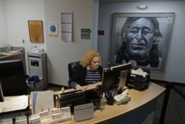 Nia Tagoai, a patient scheduler at a clinic offering health care and other services operated by the Seattle Indian Health Board, works at her desk Friday, Jan. 11, 2019, in Seattle.   Fallout from the federal government shutdown is hurting hundreds of Native American tribes and entities that serve them. The pain is especially deep in tribal communities with high rates of poverty and unemployment, and where one person often supports an extended family.  (AP Photo/Ted S. Warren)