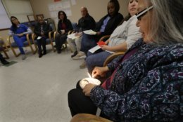 Annette Squetimkin-Anquoe, right, a member of the Colville Indian tribe and the Chief Traditional Health Officer at the Urban Indian Health Institute in Seattle, burns sage in an abalone shell, Friday, Jan. 11, 2019, during a talking circle meeting to discuss the practice of traditional Indian medicine, including blessings and smudging, with employees of the Seattle Indian Health Board.   Fallout from the federal government shutdown is hurting hundreds of Native American tribes and entities that serve them. The pain is especially deep in tribal communities with high rates of poverty and unemployment, and where one person often supports an extended family.  (AP Photo/Ted S. Warren)