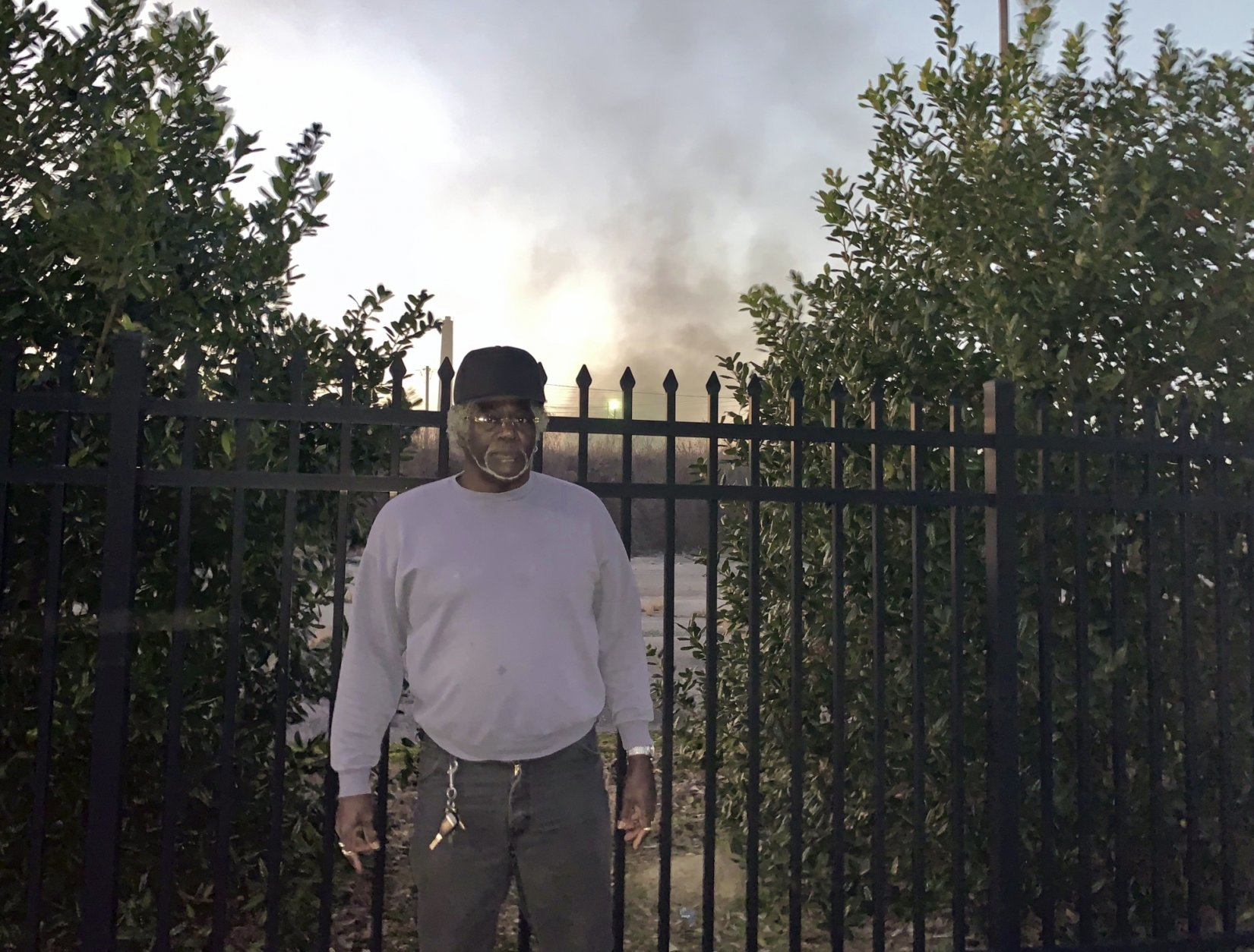 """Charlie Powell stands outside one of the industrial sites at the 35th Avenue Superfund site in Birmingham, Ala., Wednesday, Jan. 9, 2019. The EPA has been removing contaminated soil from yards in the neighborhoods within the site. The partial government shutdown has forced suspension of federal work at the nation's Superfund sites unless it is determined there is an """"imminent threat"""" to life or property. (AP Photo/Kimberly Chandler)"""