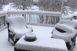Snow blankets patio furniture in Gainsville, Va. (Courtesy of Heidi Rhodes via Twitter)