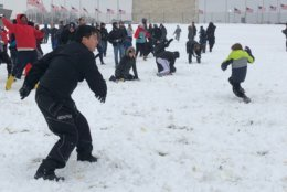 The Washington Monument was the site of a massive snowball fight on Sunday. (WTOP/Keara Dowd)