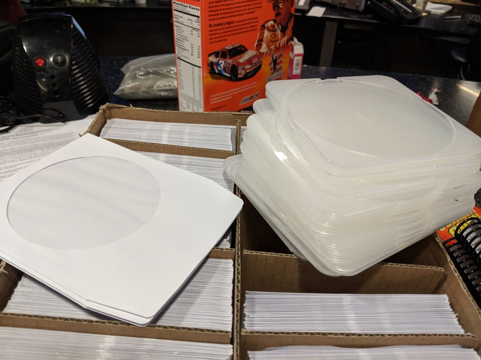 Here's a whole box full of plastic and paper sleeves for disc media, all of which would have been more useful during the Clinton administration. (WTOP/Jack Pointer)