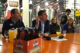 Sen. Mark Warner, D-Va., sponsored the gathering Wednesday at the Port City Brewing Companyin Alexandria, Virginia, where founder and CEO Bill Butcher talked about issues shared by craft brewers locally and nationwide. (WTOP/Kristi King)