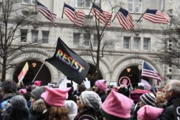 The 2019 Women's March passed directly in front of the Trump International Hotel — a common site for protesters seeking to express their frustration and misgivings with President Trump. The half-mile march featured thousands of people, including some furloughed federal workers, advocating for women's rights and calling for Trump's removal from office. (WTOP/Alejandro Alvarez)