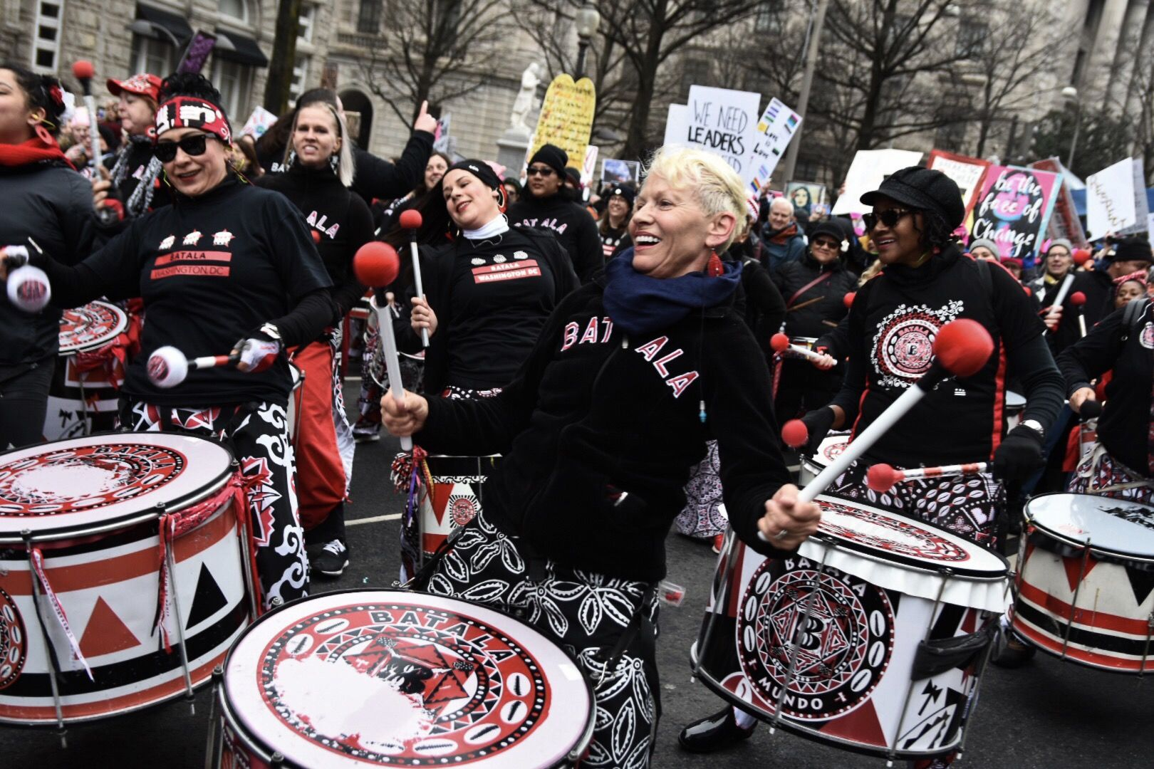 """Drummers with Batala Washington, an """"all-women Afro-Brazilian band that plays Samba-Reggae rhythms,"""" played non-stop for the duration of the march near Freedom Plaza. (WTOP/Alejandro Alvarez)"""