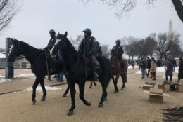 Park Police bundled up on a cold wet Friday for the annual March for Life. (WTOP/Max Smith)