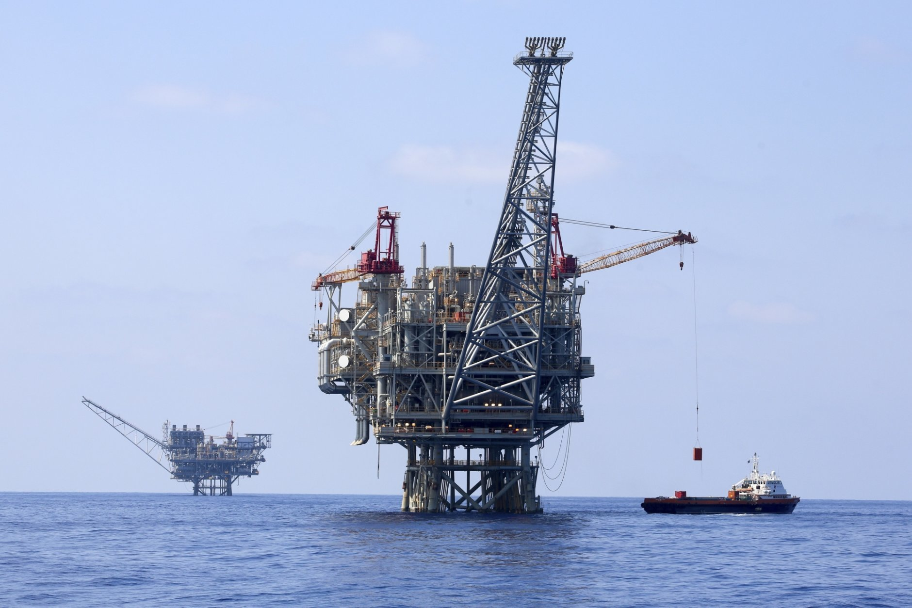 File - In this Sept. 2, 2015 file photo rigs are seen in Tamar natural gas field in the Mediterranean Sea off the coast of Israel. Israel's Delek Drilling and its U.S. partner, Noble Energy, said Sunday the foundation of their rig for the Leviathan gas field has arrived, in the first stage of an ambitious project they say will wean Israel off coal and revolutionize its economy by turning it into an energy exporter. (AP Photo/Marc Israel Sellem, File)