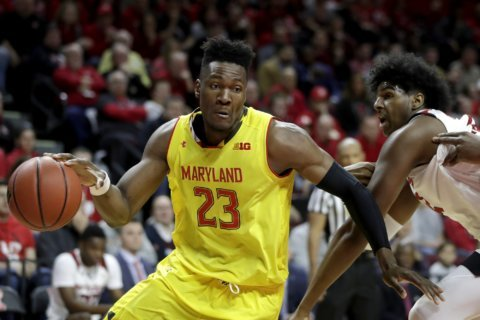 Smith helps Maryland roll past Rutgers 77-63