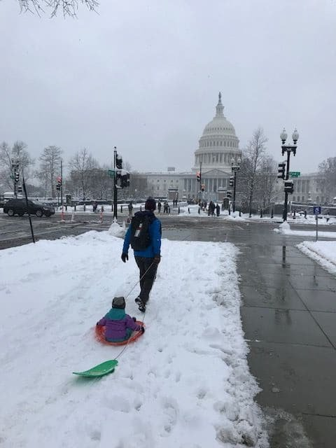 People make their way towards Capitol Hill for some sledding. (WTOP/Mitchell Miller)