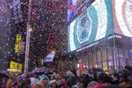 Revelers celebrate in Times Square in New York, Tuesday, Jan. 1, 2019, during a New Year's celebration. (AP Photo/Craig Ruttle)