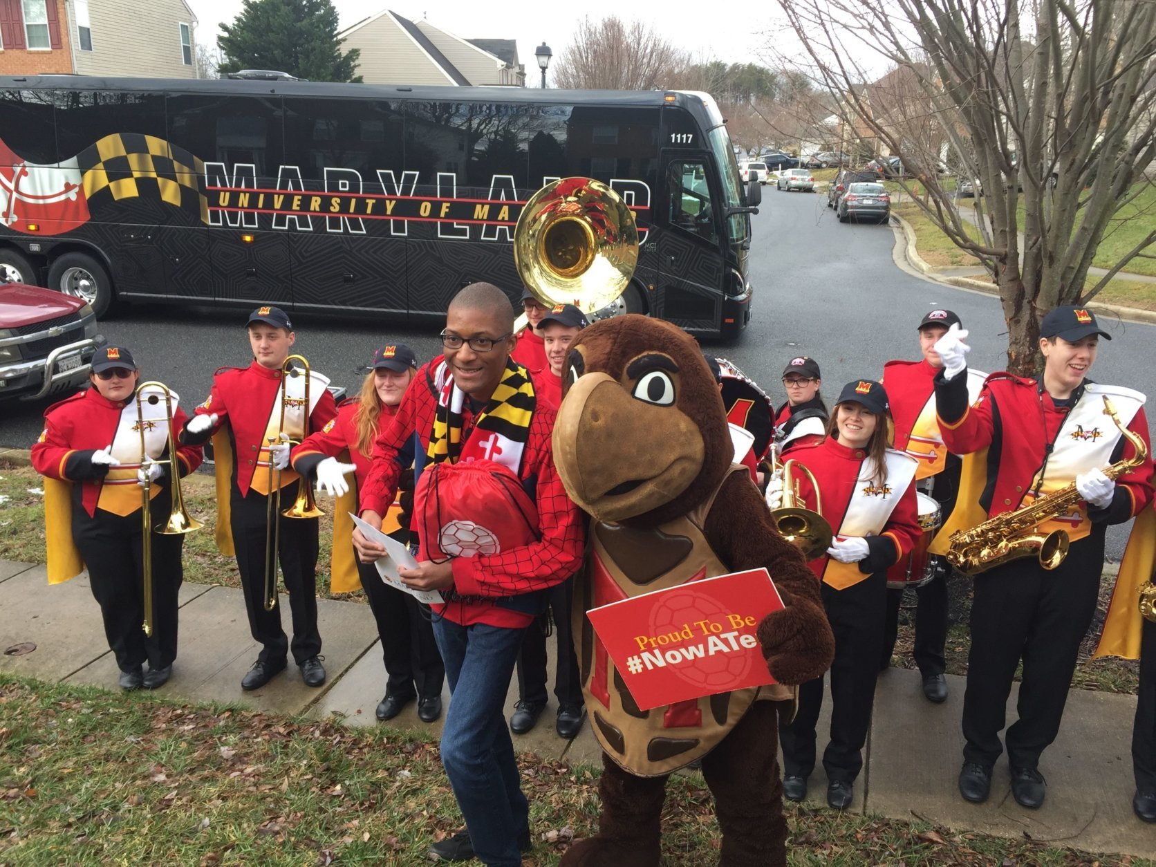 Members of the UMD marching band along with the university's mascot were among those to congratulate Jones on his acceptance to the school. (WTOP/John Domen)