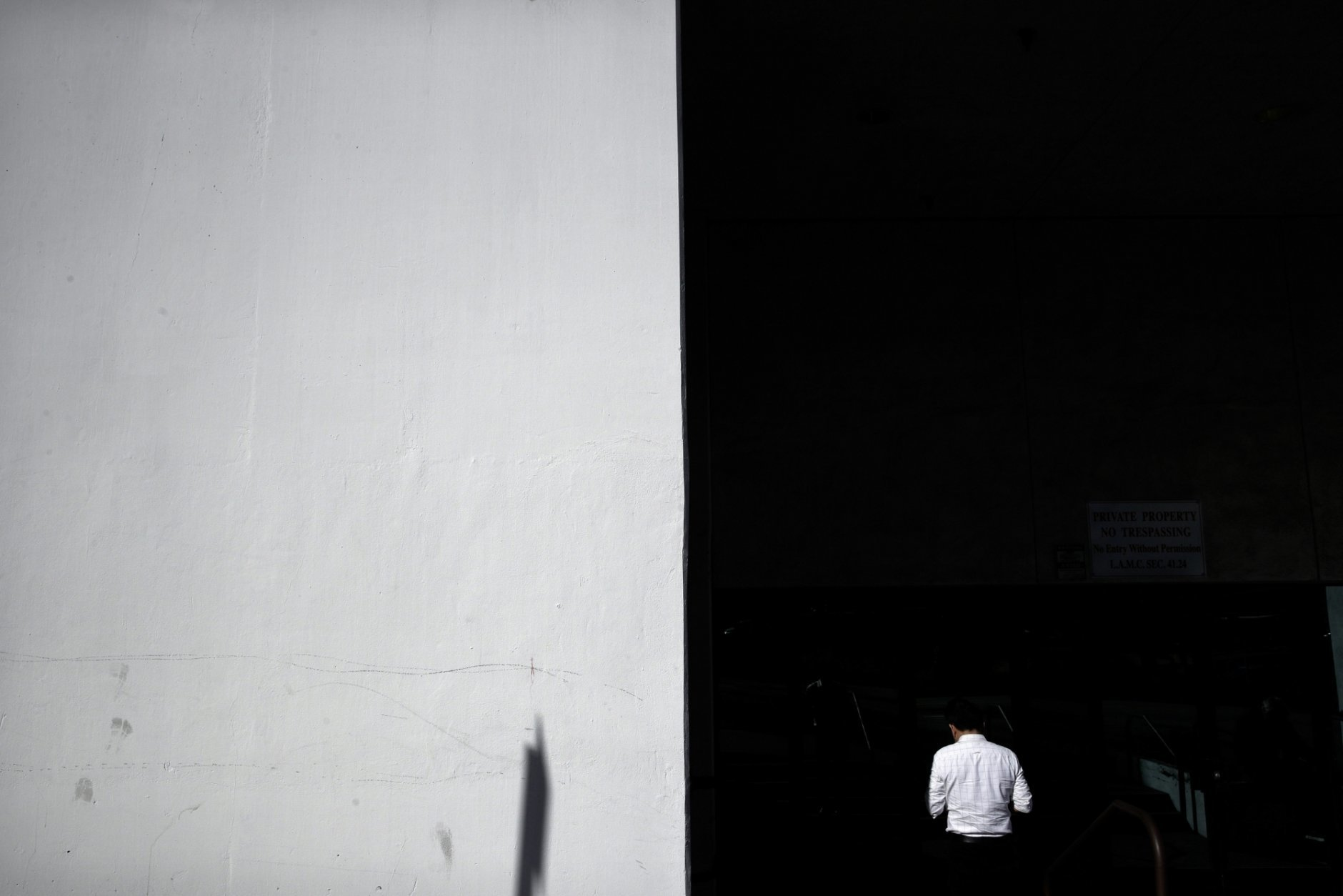 A man is lit by the morning sun during a walk in Los Angeles on Wednesday, Jan. 9, 2019. (AP Photo/Jae C. Hong)