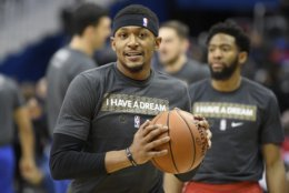 Washington Wizards guard Bradley Beal wears a shirt in tribute of Martin Luther King Jr. during warm ups before an NBA basketball game against the Detroit Pistons, Monday, Jan. 21, 2019, in Washington. (AP Photo/Nick Wass)