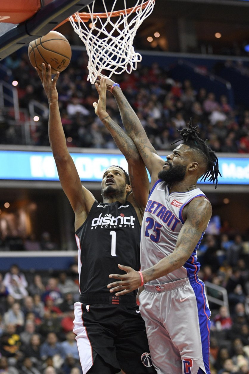 Washington Wizards forward Trevor Ariza (1) goes to the basket against Detroit Pistons guard Reggie Bullock (25) during the second half of an NBA basketball game, Monday, Jan. 21, 2019, in Washington. Bullock was called fora foul on the play. The Wizards won 101-87. (AP Photo/Nick Wass)