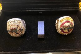 """Leonsis brought both of his Capitals championship rings. The red one (right) was the official ring, but they also made a white gold/platinum """"away"""" version of the ring. (WTOP/Julia Ziegler)"""