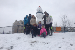 "This WTOP listener said they helped make the ""biggest snowman in the neighborhood"" in Woodbridge, Virginia. There was also a lot of sledding involved. (Courtesy Kamaljit Chawla)"