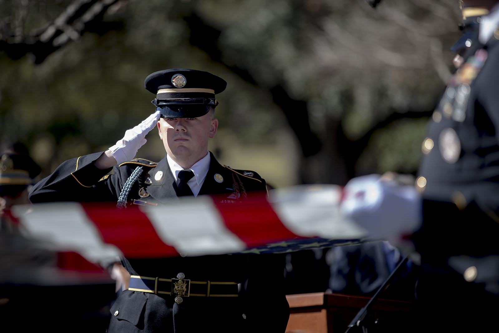 Members of an honor guard readies to fold an American flag that was draped on the casket of WWII veteran Richard Overton during a burial ceremony at the Texas State Cemetery on Saturday, Jan. 12, 2019, in Austin, Texas.  Overton, who died on Dec. 27, 2018, was the nation's oldest living World War II veteran. (Nick Wagner/Austin American-Statesman via AP)