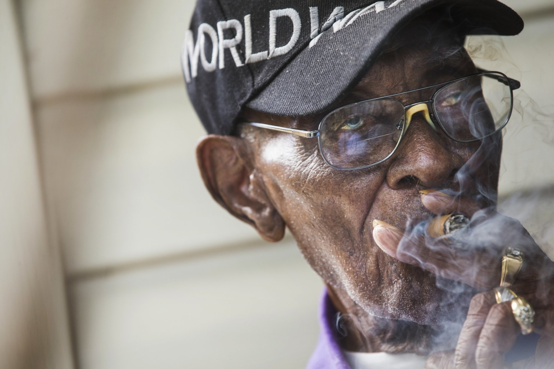 FILE - In this May 10, 2018 file photo, Richard Overton, America's oldest living WWII veteran, sits on his porch in Austin, Texas. Overton, who died Dec. 27, 2018, was remembered Saturday, Jan. 12, 2019 during his funeral in Austin for his love of country and joy for life. (Amanda Voisard/Austin American-Statesman via AP)