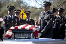An honor guard walks with the casket of WWII veteran Richard Overton during a burial ceremony at the Texas State Cemetery on Saturday, Jan. 12, 2019, in Austin, Texas. Overton, the nation's oldest World War II veteran who at 112 was believed to be the oldest living man in the U.S., was remembered for his love of country and joy for life. (Nick Wagner/Austin American-Statesman via AP)